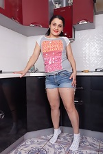 Sanita has fun stripping naked in her kitchen